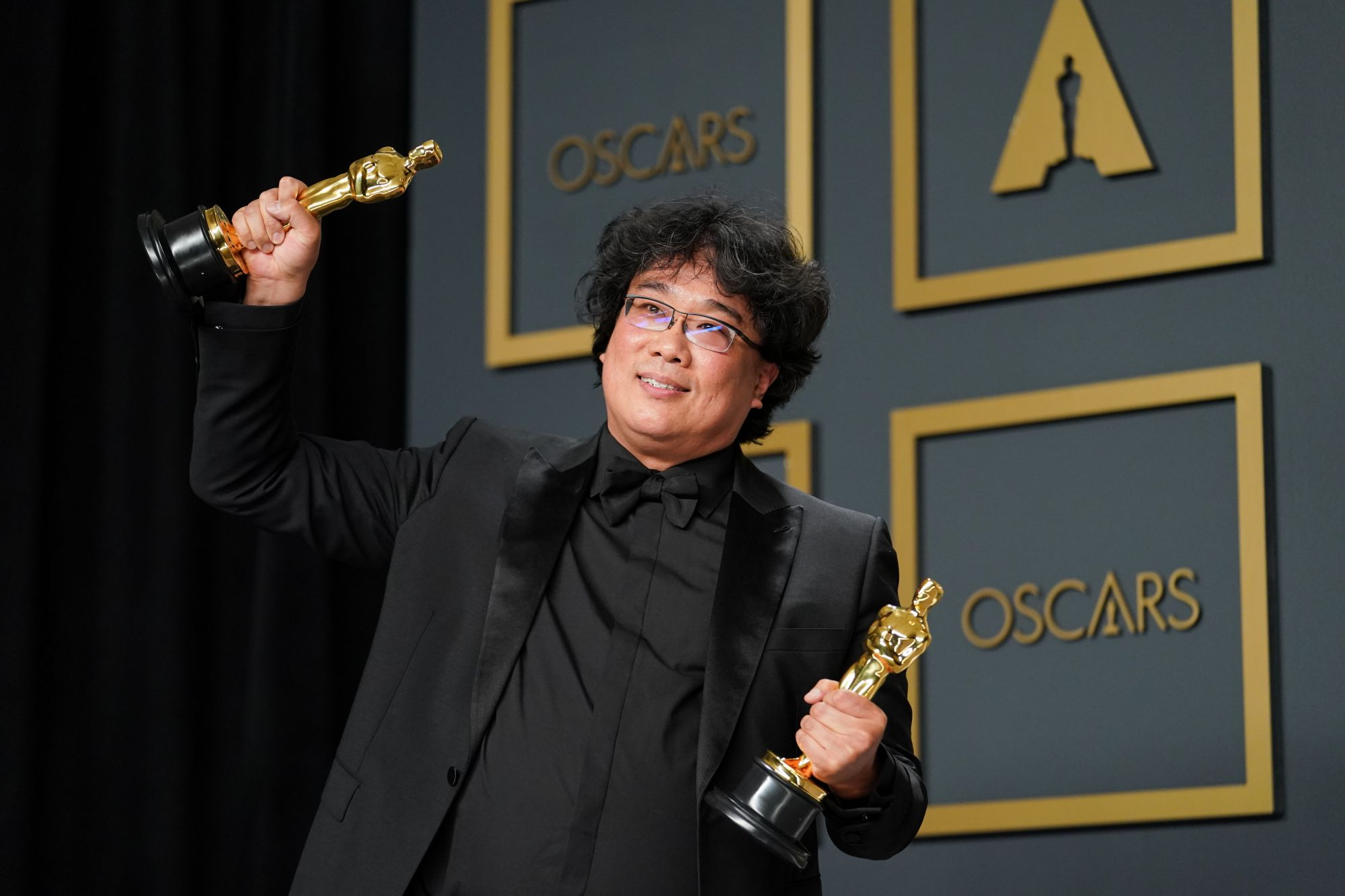"""HOLLYWOOD, CALIFORNIA - FEBRUARY 09: Bong Joon-ho, winner of the Original Screenplay, International Feature Film, Directing, and Best Picture award for """"Parasite,"""" poses in the press room during the 92nd Annual Academy Awards at Hollywood and Highland on February 09, 2020 in Hollywood, California. (Photo by Rachel Luna/Getty Images)"""