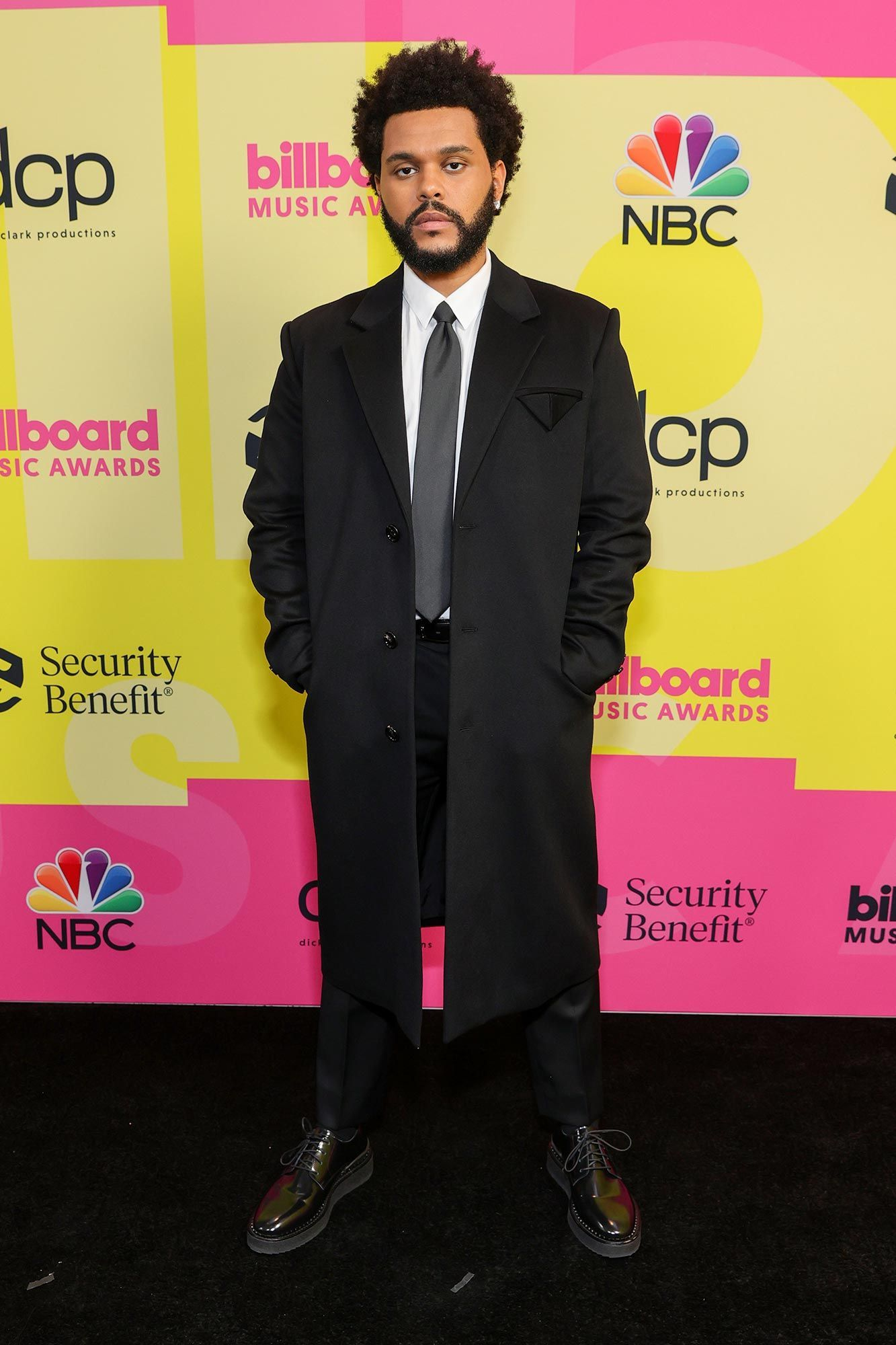 The Weeknd at the 2021 Billboard Music Awards wearing a black suit