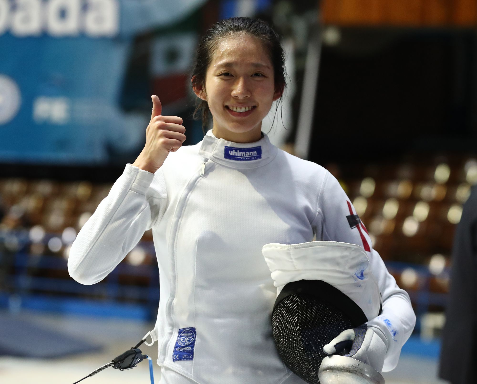 HAVANA, CUBA - JANUARY 12:  Man Wai Vivian Kong of Hong Kong China gives a thumbs up after a victory during the elimination rounds at the Women's Epee World Cup on January 12, 2019 at the Coliseo de la Ciudad Deportiva in Havana, Cuba. (Photo by Devin Manky/Getty Images)