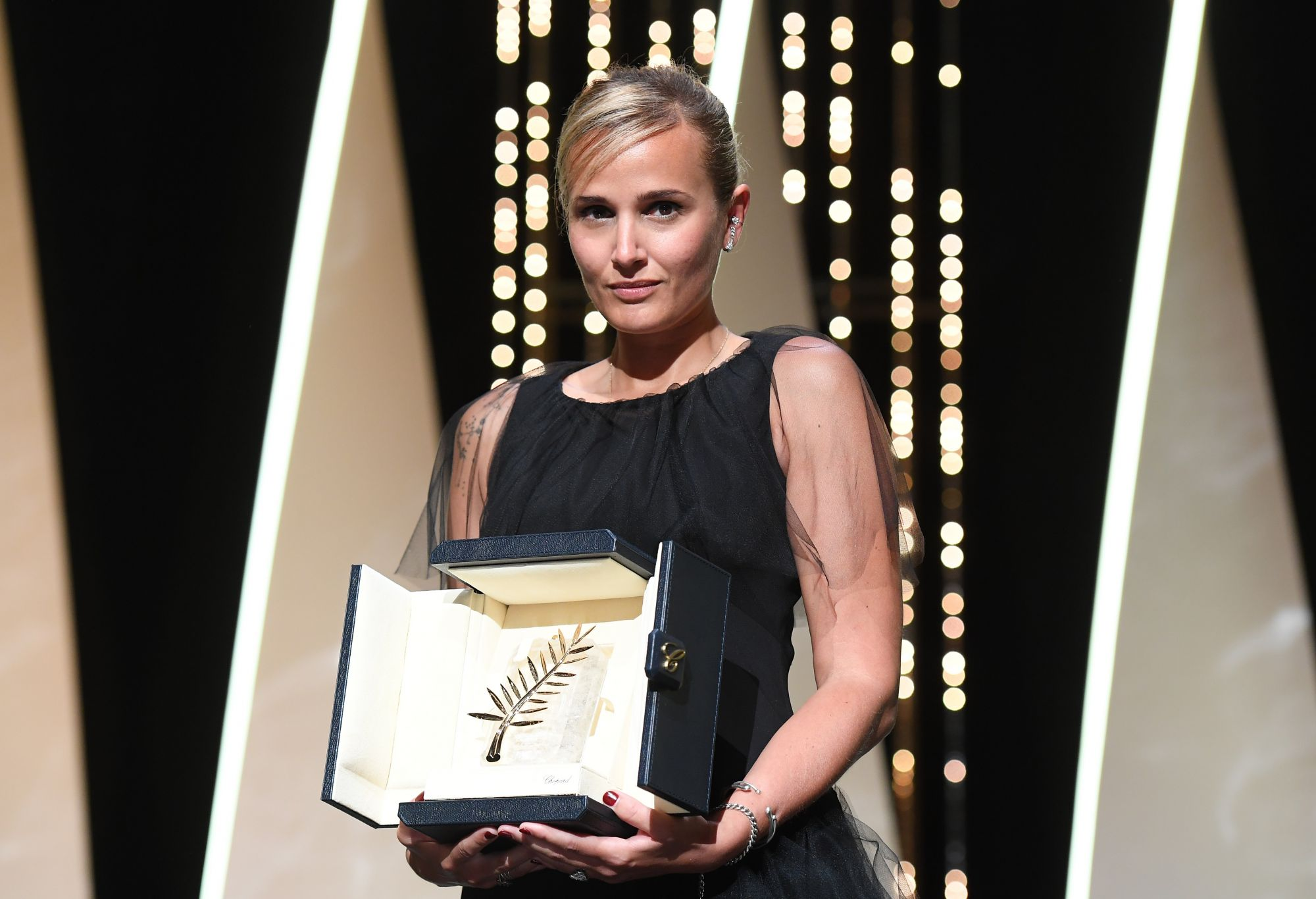 CANNES, FRANCE - JULY 17: Julia Ducournau poses with the Palme d'Or 'Best Movie Award' for 'Titane' during the closing ceremony of the 74th annual Cannes Film Festival on July 17, 2021 in Cannes, France. (Photo by Stephane Cardinale - Corbis/Corbis via Getty Images)