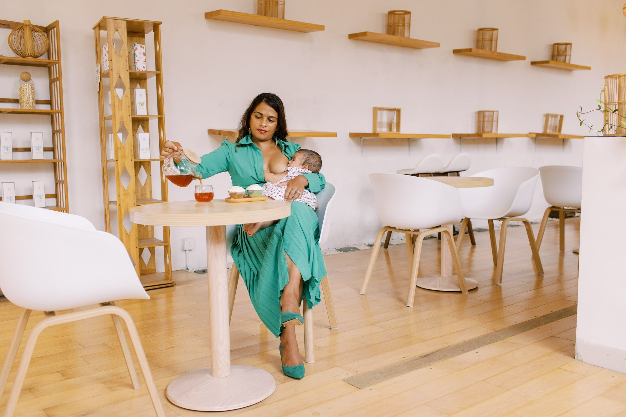 Liz Thomas, founder of the It Tastes Like Love Campaign, sits breastfeeding her baby in a Hong Kong cafe