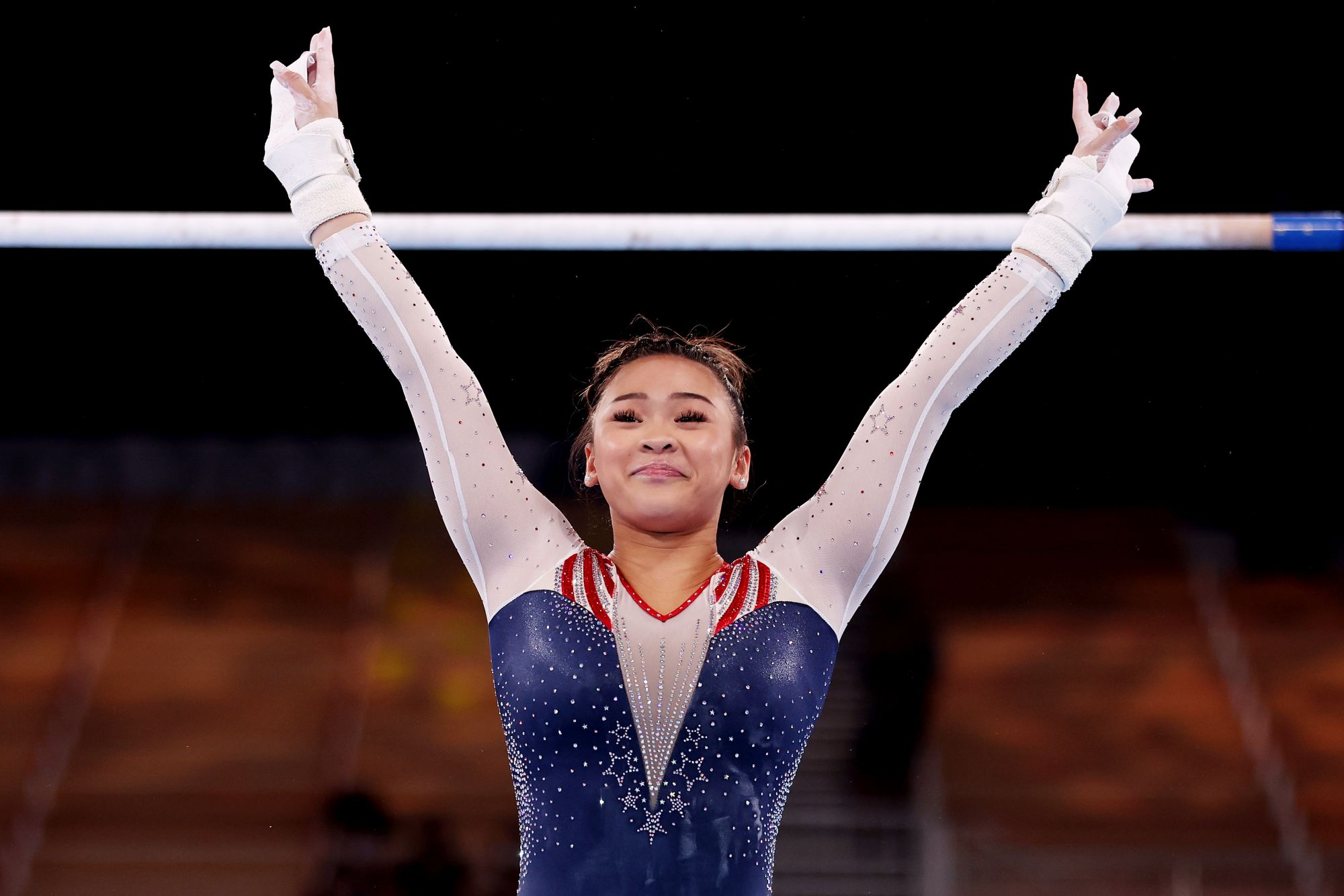 TOKYO, JAPAN - JULY 29: Sunisa Lee of Team United States reacts after competing on uneven bars during the Women's All-Around Final on day six of the Tokyo 2020 Olympic Games at Ariake Gymnastics Centre on July 29, 2021 in Tokyo, Japan. (Photo by Jamie Squire/Getty Images)