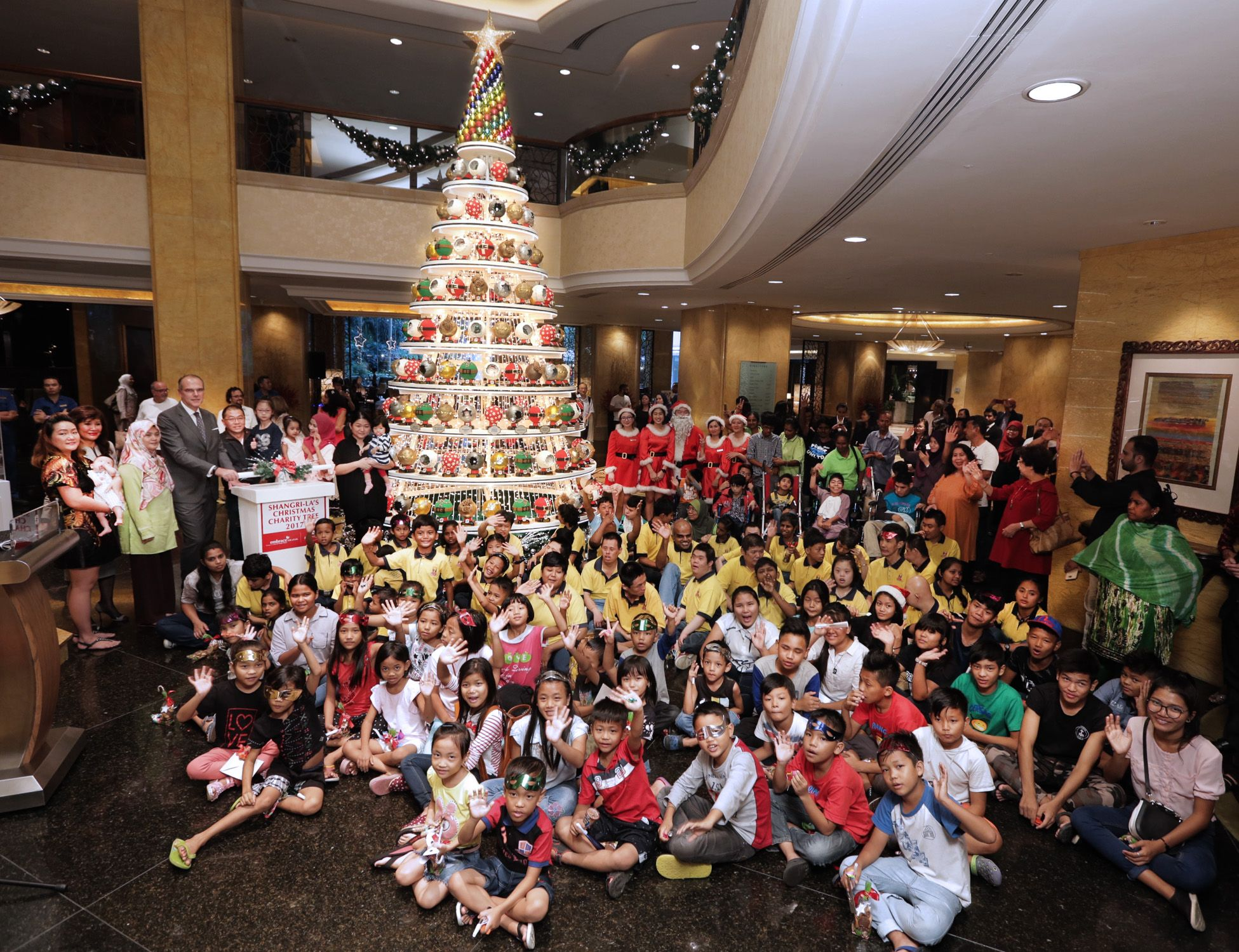 Manfred Weber - standing fourth from left - area general manager of Shangri-La Hotel Kuala Lumpur,  lighted up 'The Glittering Baubles of Life' Christmas tree