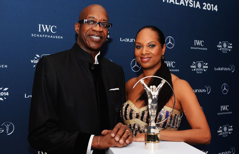 Edwin Moses, chairman of the Laureus World Sports Academy and wife, Michelle Moses