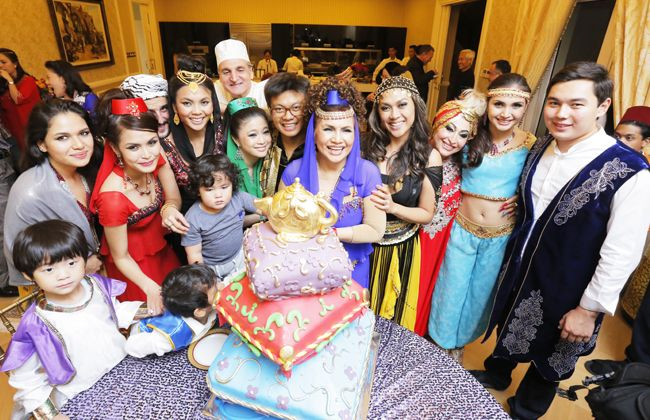Datuk Raziah Mahmud-Geneid makes a wish and cuts her birthday cake with her beloved family