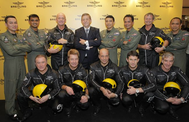 Royal Malaysian Airforce and  Pilots of the Breitling Jet Team posing for the Breitling store opening