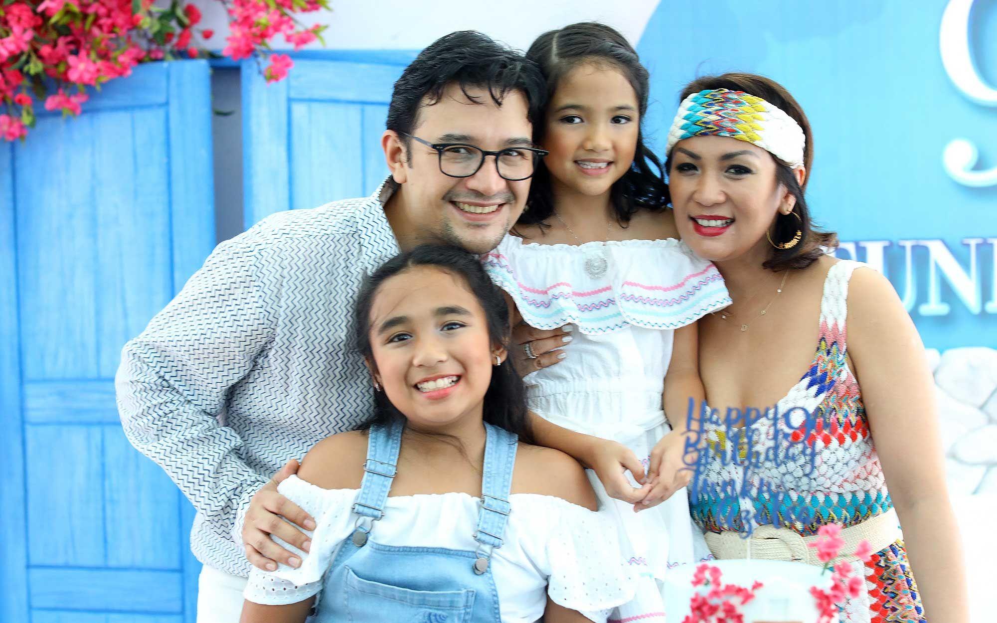 Tunku Mohamed Alauddin and Puteri Badrinise Zakuan-Naquiyuddin with Tunku Alaynna Puteri and Tunku Azalea Puteri