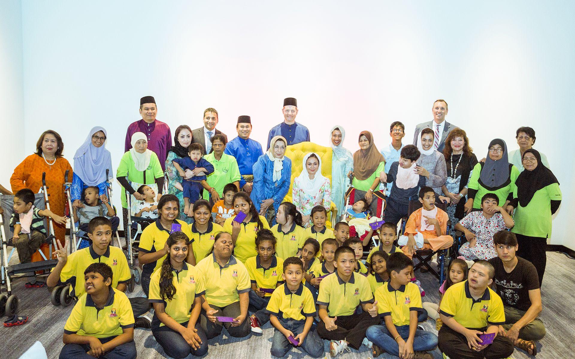 Tengku Permaisuri Norashikin with the children from Tasputra Perkim and Taman Megah children's home