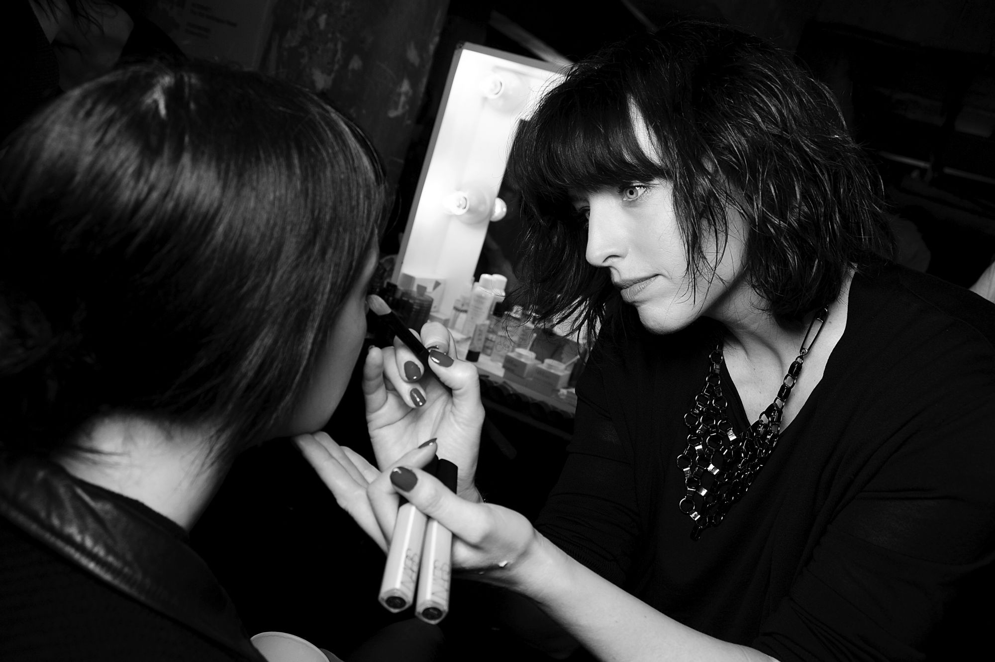 Global Artistic Director, Jane Richardson, backstage prepping models for a fashion show. Photo: Courtesy of NARS Cosmetics