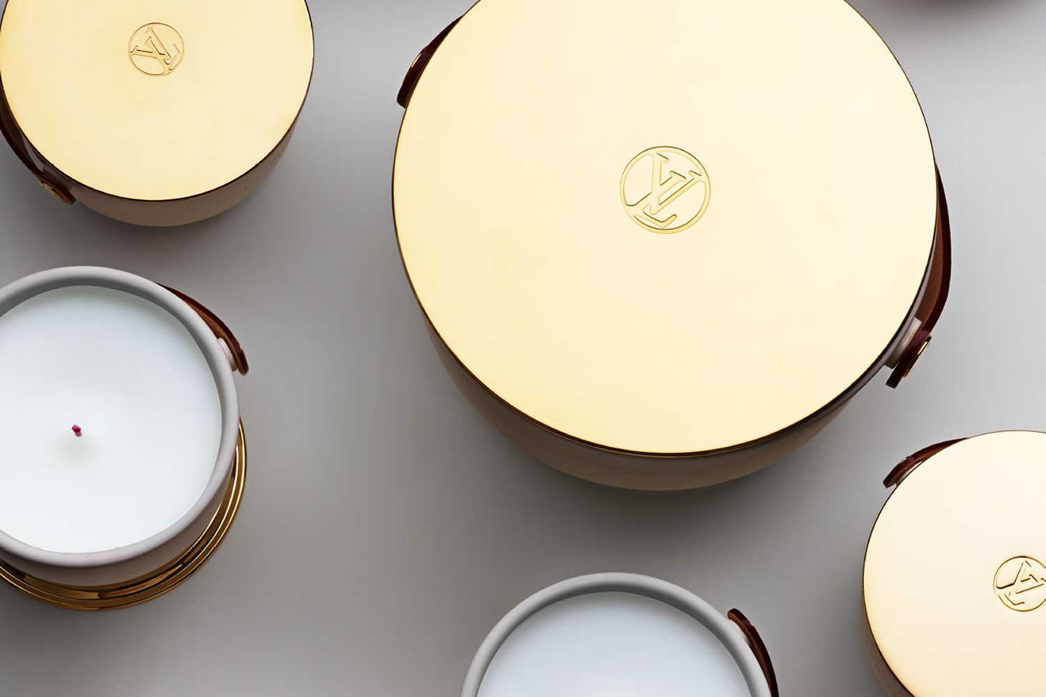 Introducing the deluxe edition of Louis Vuitton's L'Air du Jardin, Ile Blanche, Feuilles d'Or and Dehors Il Neige scented candles. (Photo: Courtesy of Louis Vuitton)