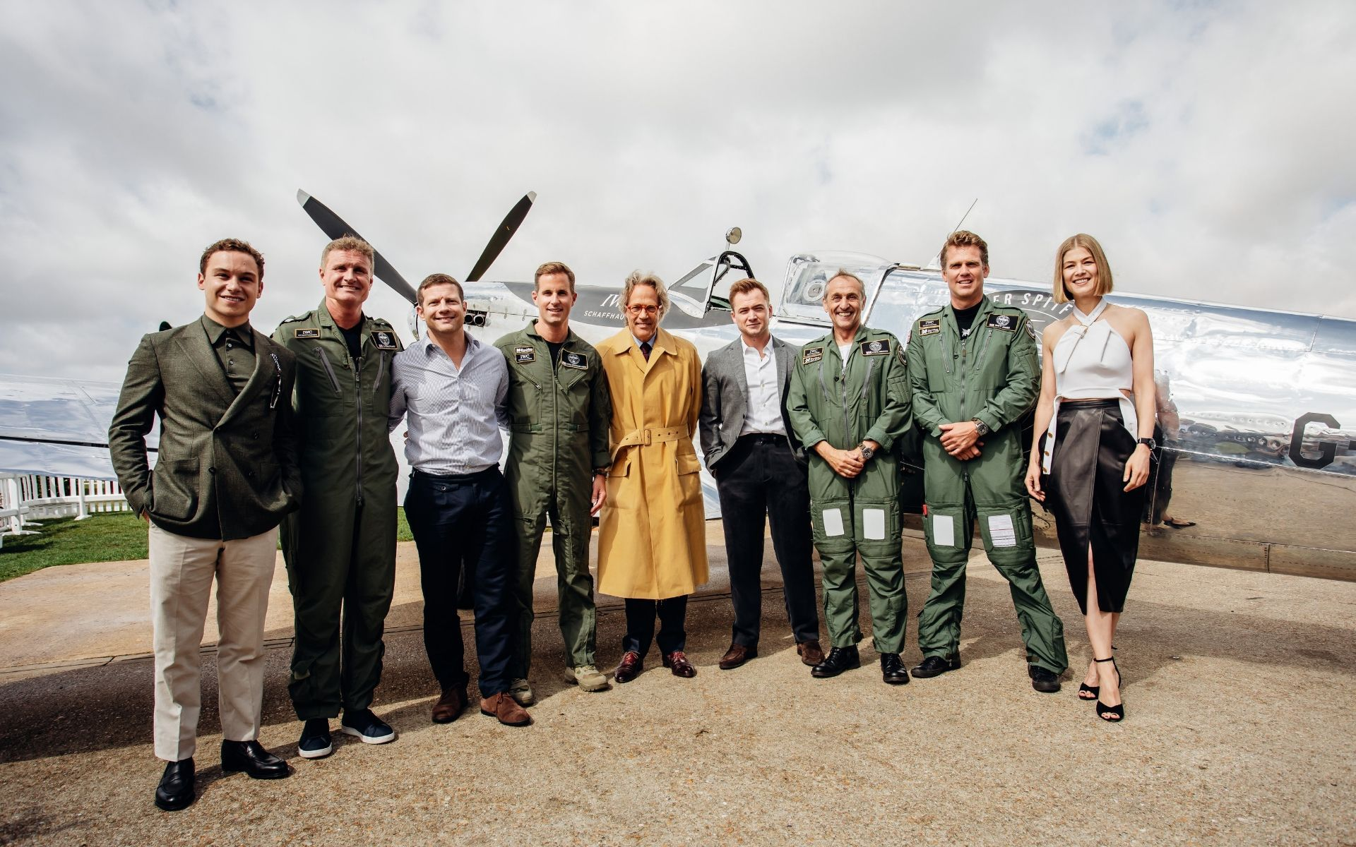 A group shot in front of the Silver Spitfire: Finn Cole, David Coulthard, Dermont O'Leary, Christoph Grainger-Herr, the Duke of Richmond, Taron Egerton, Steve Boultbee Brooks, Matt Jones and Rosamund Pike