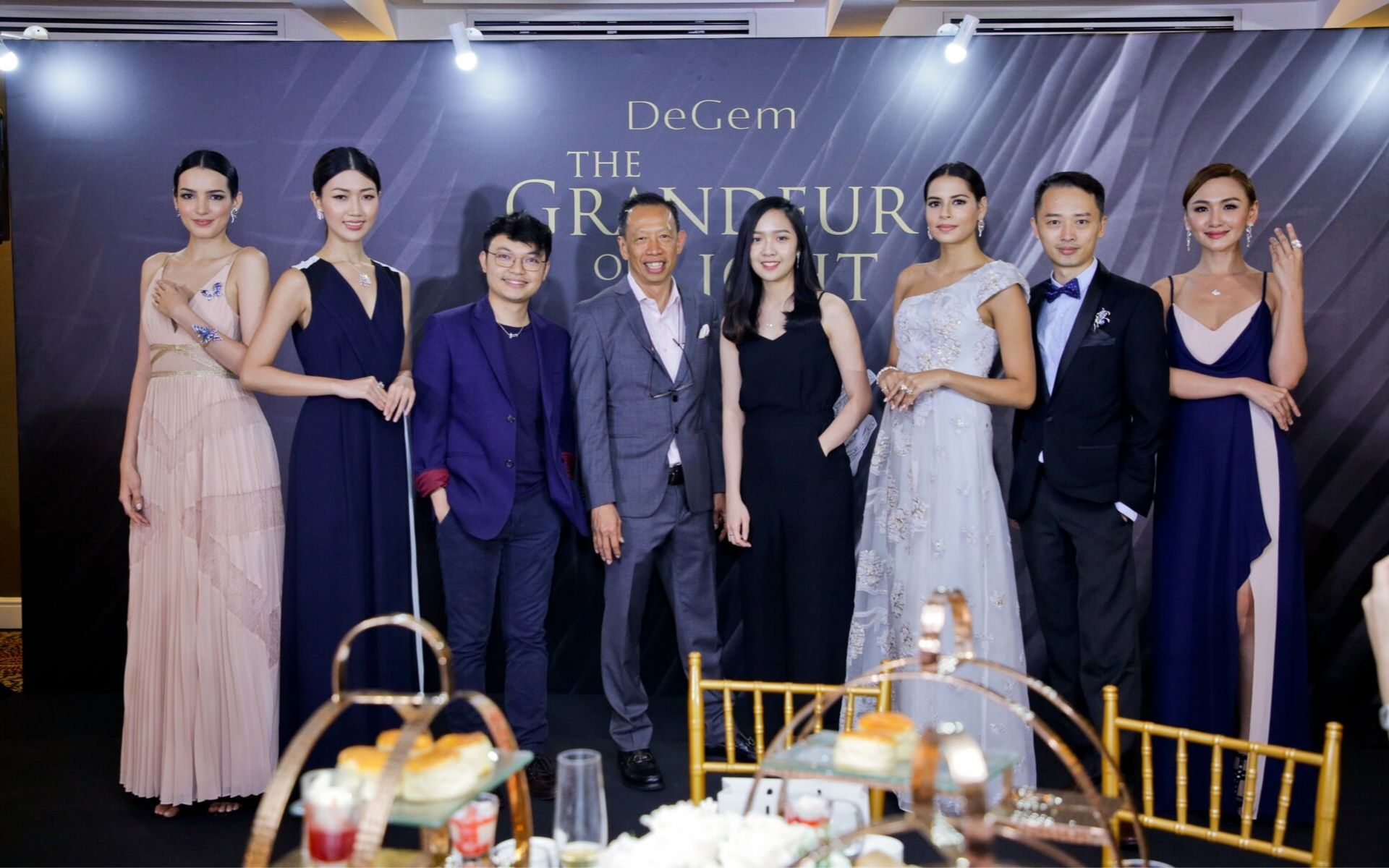 Freedome Choong, Stephen Choong, Leong Su Ling and Yew Yong Hee posing with DeGem models