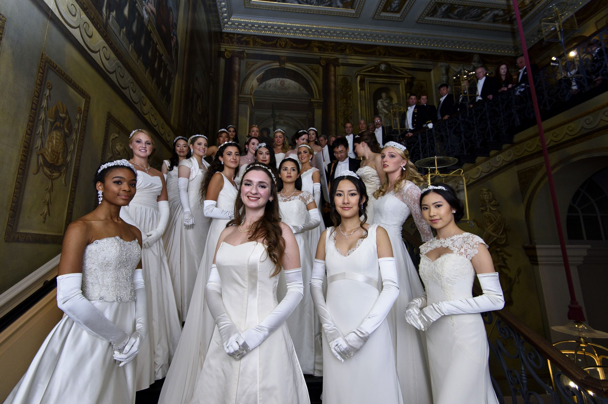 Debutantes and their farthers pose ahead of the Queen Charlotte Ball on September 11, 2015 (Photo credit: The London Season official website)