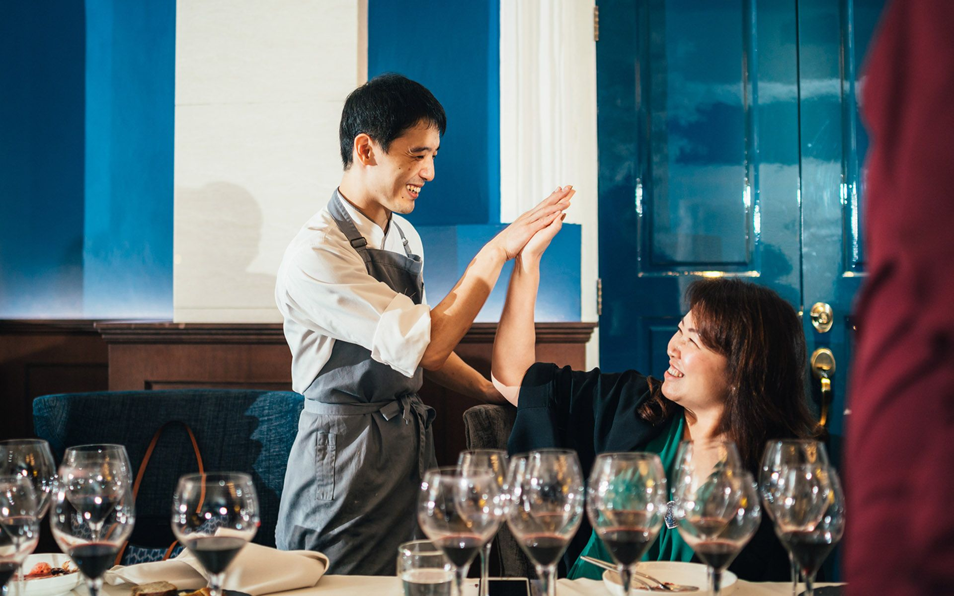 Chef Takuya and Datin Karen H'ng giving each other a high-five over the success of the wine dinner