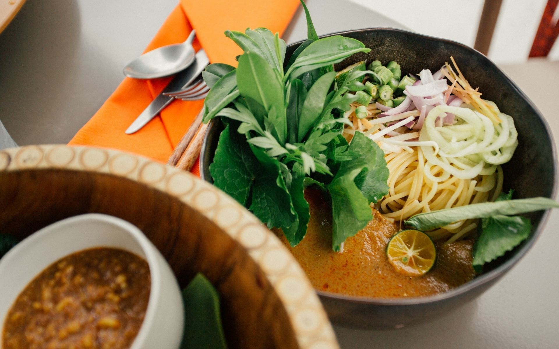 The garnishes for the laksa are from the chef's garden on-site