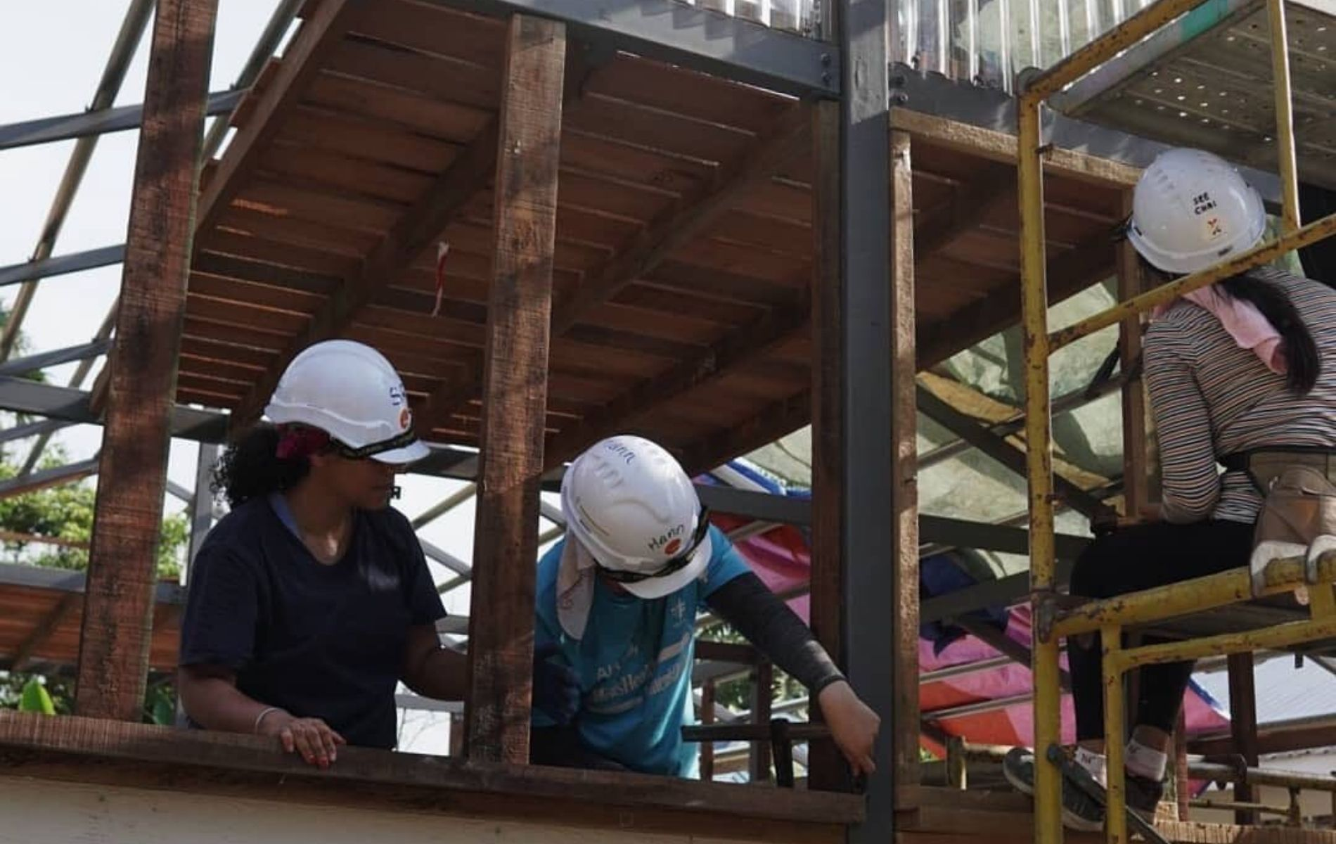 Volunteers building a home for the orang asli