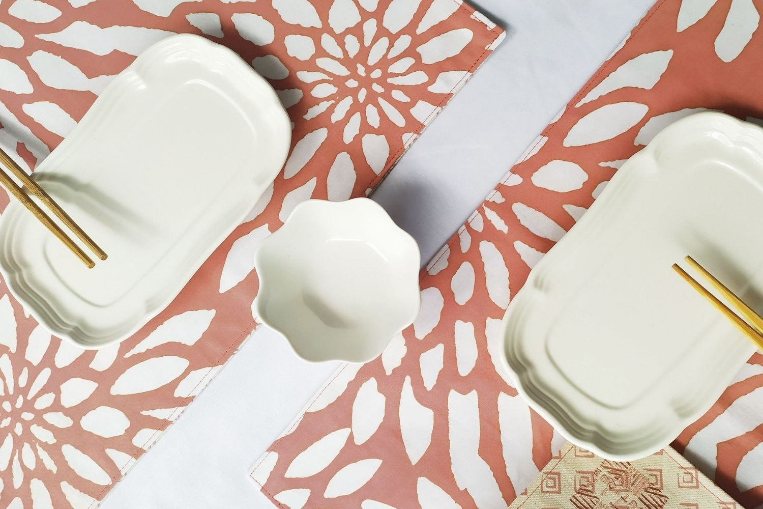 """Coral Bunga reversible placemat set of two, from <a href=""""https://www.thebatikboutique.com/collections/homeware/products/placemat-set-reversible-coral-bunga/"""" target=""""_blank"""" rel=""""noopener"""">The Batik Boutique</a>"""