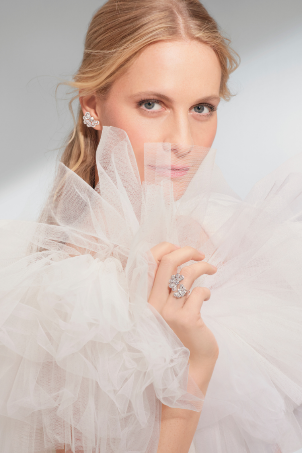 Poppy Delevingne wearing Nuage earrings and ring in 18k white gold set with pear-shaped and brilliant-cut diamonds