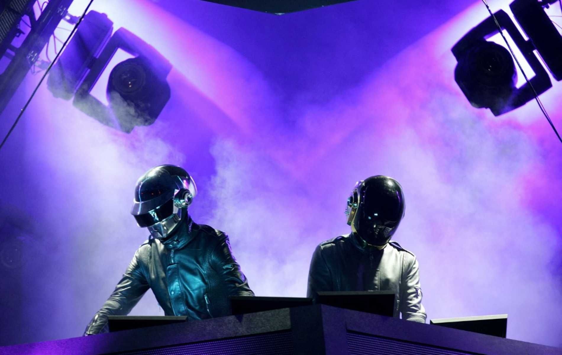 """(FILES) In this file photo taken on April 29, 2006 Daft Punk performs at the Coachella Music Fesival in Indio, California. - French electronic music stars Daft Punk have split up, their publicist confirmed on February 22, 2021, ending one of the era's defining dancefloor acts. The duo released a video titled """"Epilogue"""" in which one of the robot duo is blown up in the desert, followed by a cutaway reading """"1993-2021"""". (Photo by Karl Walter / GETTY IMAGES NORTH AMERICA / AFP)"""