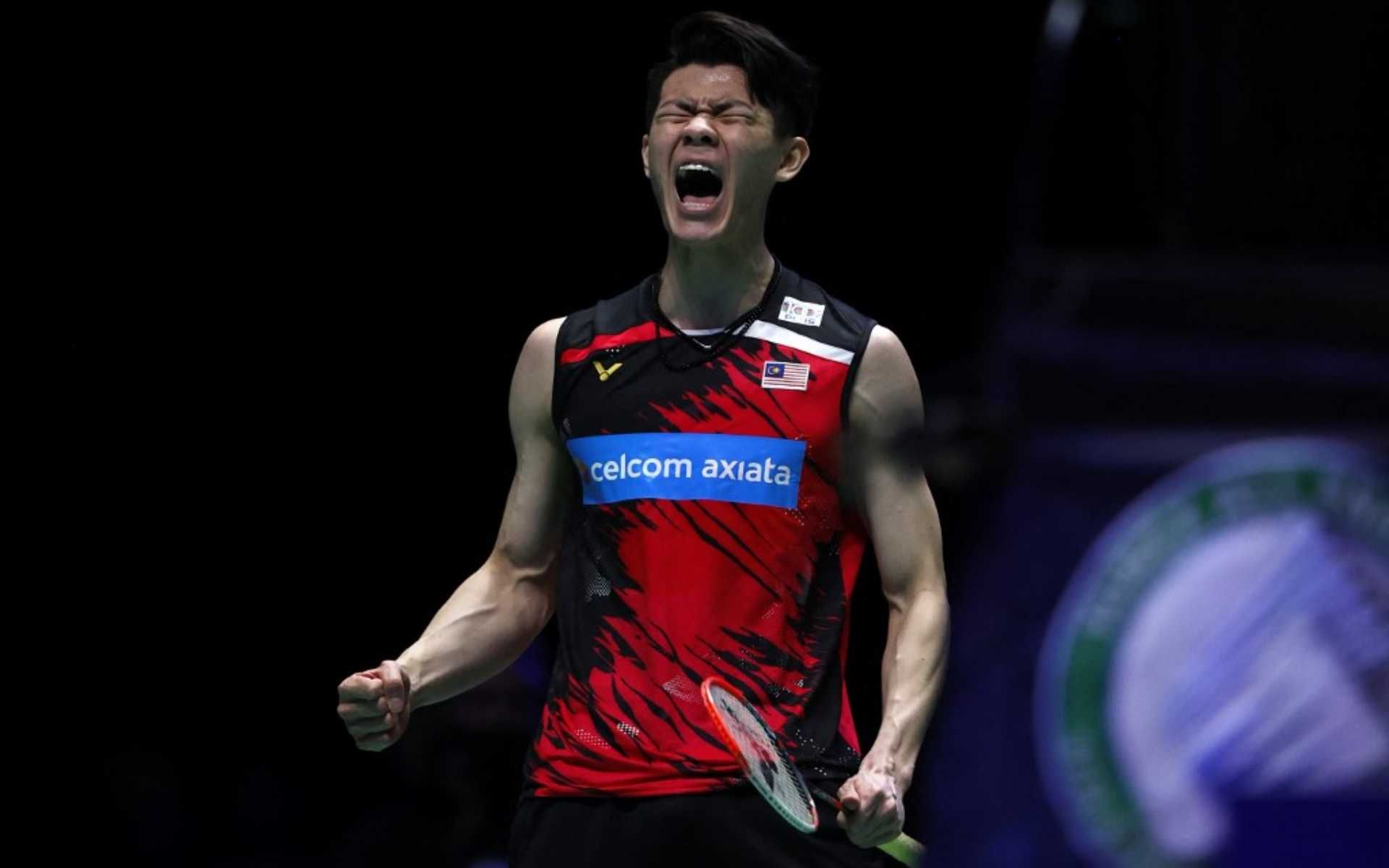 Malaysia's Lee Zii Jia celebrates winning a point after a long rally against Denmark's Viktor Axelsen during the men's singles final on the last day of the All England Open Badminton Championship at the Utilita Arena in Birmingham, central England, on March 21, 2021. (Photo by Adrian DENNIS / AFP)
