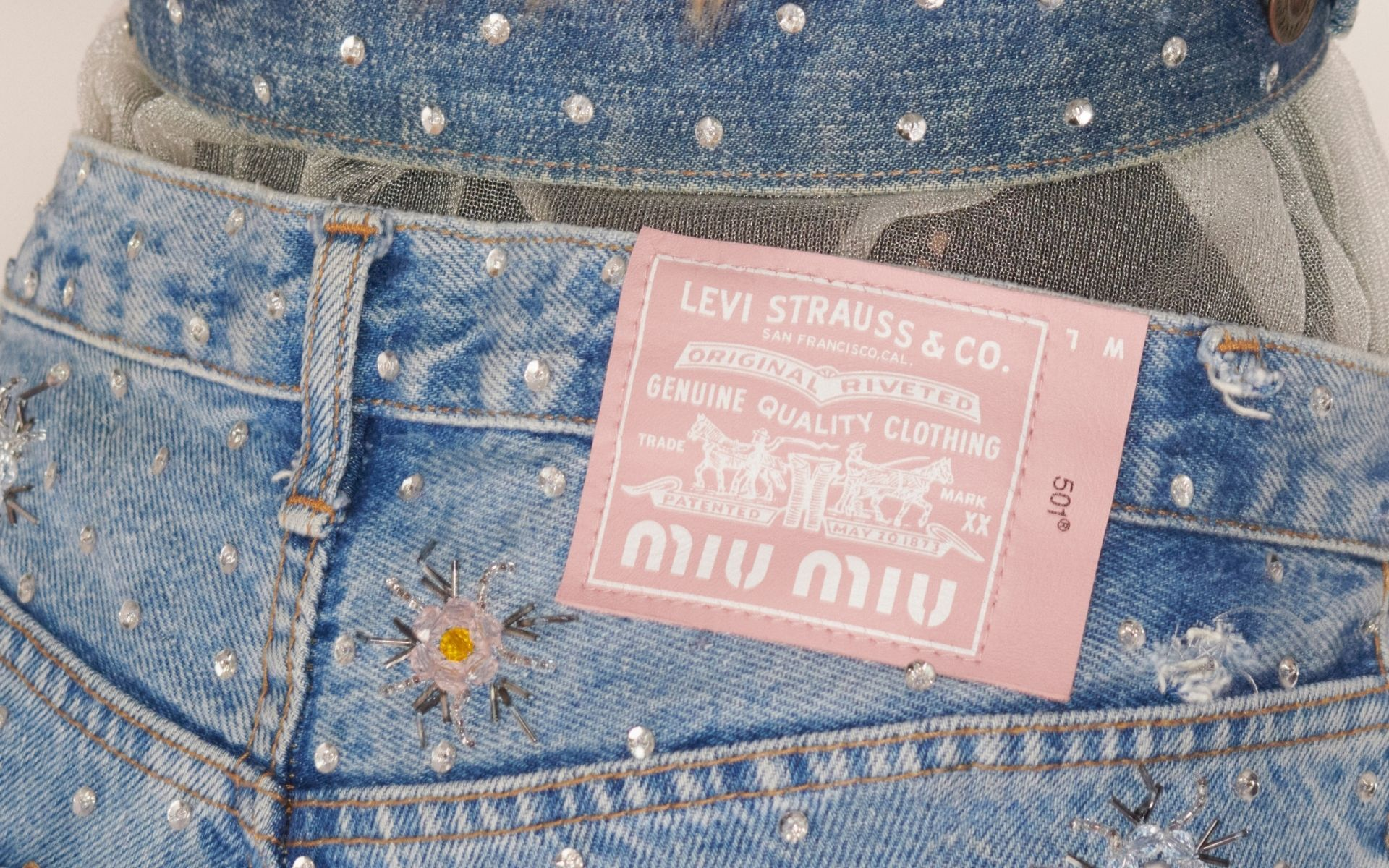 The iconic Levi's® backpatch is re-invented in Miu Miu pink, featuring both logos side by side.