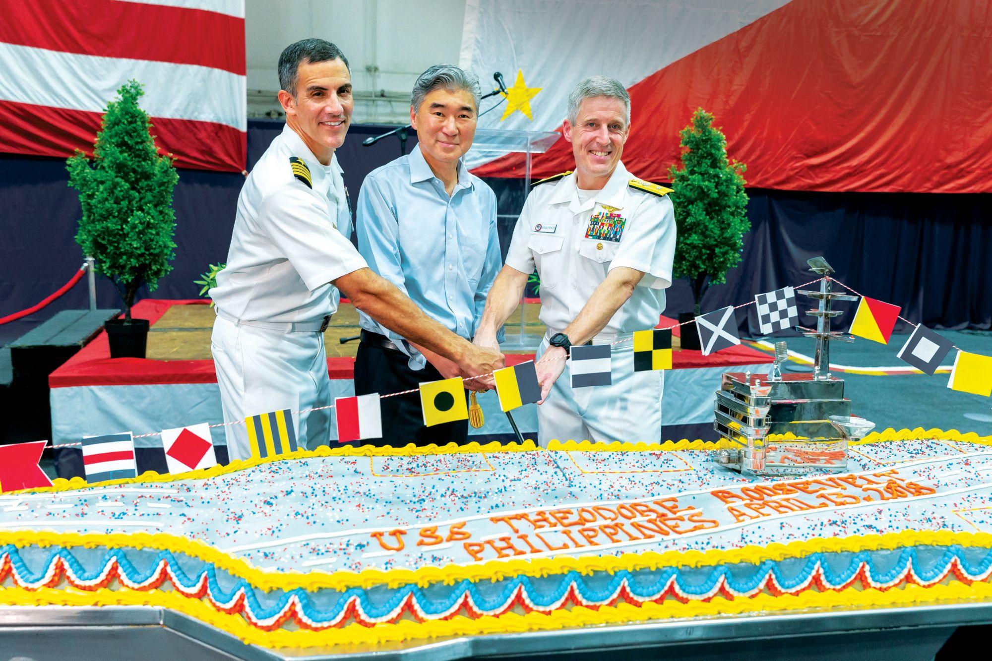Captain Carlos Sardiello, Ambassador Sung Kim, and Rear Admiral Steve Koehler