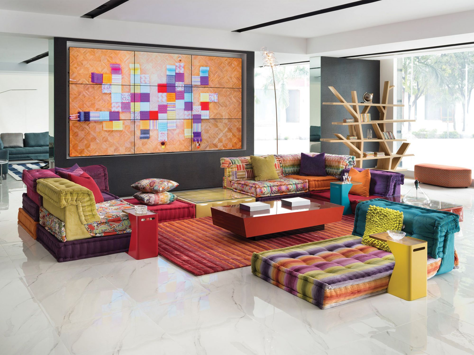 Originally created by the German designer Hans Hopfer in 1971, the colourful and modular Mah Jong sofa adds a sense of playfulness and fun to a sitting room. Available at Roche Bobois.