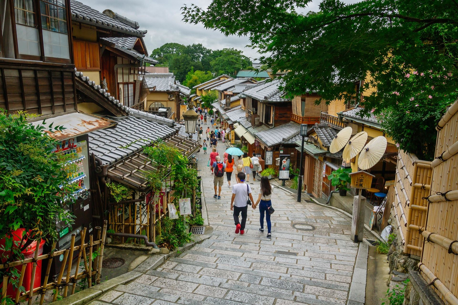 Kyoto, Japan - July 23, 2015: Tourists are enjoying on the Sannen-Zaka, Kyoto famous preserved street on July 21 2015 which located in the Gion district. Many souvenir shops can be found here.