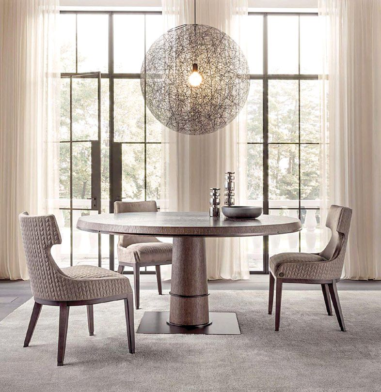Oak and metal pair up beautifully in Medea Lifestyle's Tower round table, more so when matched with Kelly chairs in wood and fabric. Available at Furnitalia