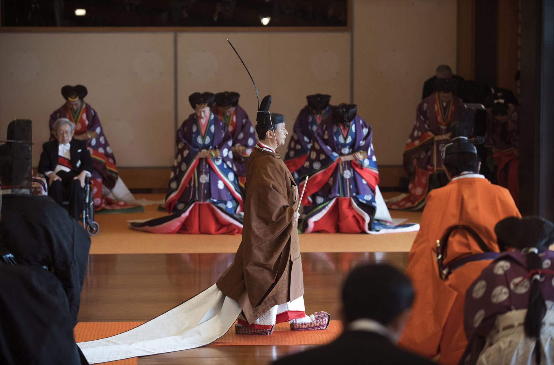 Japan's Emperor Naruhito (C) leaves at the end of the enthronement ceremony where he officially proclaimed his ascension to the Chrysanthemum Throne at the Imperial Palace in Tokyo on October 22, 2019. (Photo by Kazuhiro NOGI / POOL / AFP)