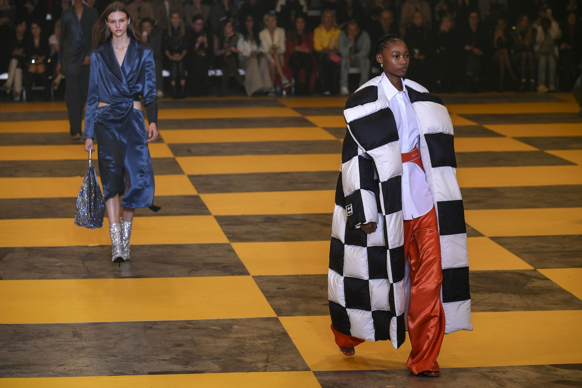 Models present creations by Off-White during the Women's Fall-Winter 2019/2020 Ready-to-Wear collection fashion show in Paris, on February 28, 2019. (Photo by Philippe LOPEZ / AFP)