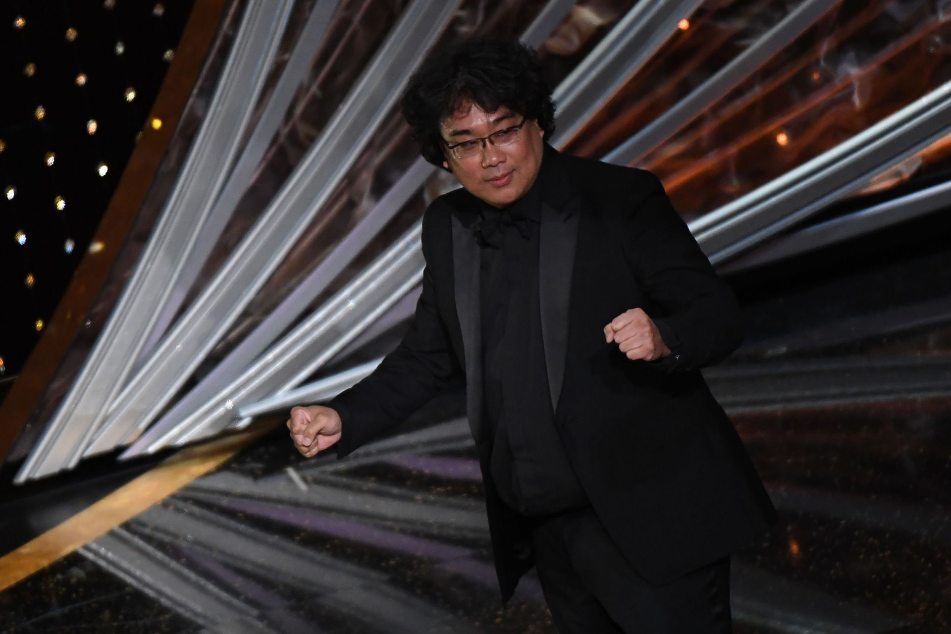 """""""Parasite"""" producer and director Bong Joon-ho celebrates after winning the award for Best Picture for """"Parasite"""" during the 92nd Oscars at the Dolby Theatre in Hollywood, California on February 9, 2020. (Photo by Mark RALSTON / AFP)"""