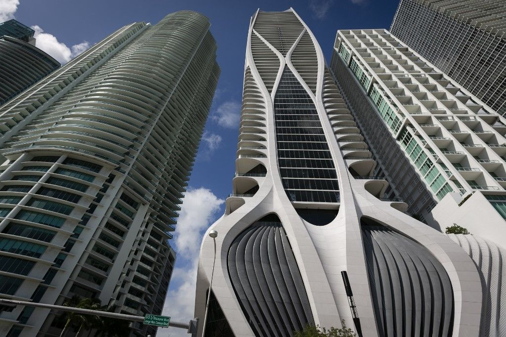 """A general view of One Thousand Museum building in Miami on February 19, 2020. - In the heart of Miami, among the towering skyscrapers that rise above the Bay of Biscayne, the eye-catching new luxury condo building by late star architect Zaha Hadid dominates the skyline.The unique curved """"exoskeleton"""" design of the One Thousand Museum building has created buzz. The futuristic building is the only residential space in downtown Miami with a helipad.The building is also a way to honor the legacy of the Iraqi-"""