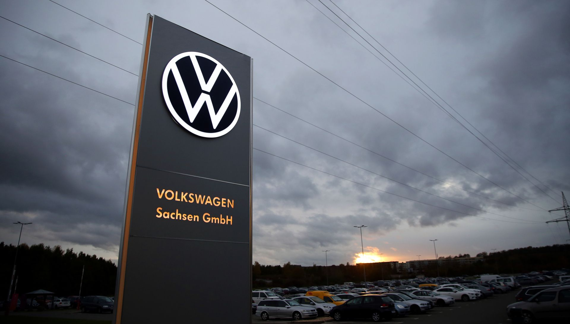 The logo of German car maker Volkswagen (VW) is pictured at the car factory in Zwickau, eastern Germany on November 4, 2019. (Photo by RONNY HARTMANN / AFP)