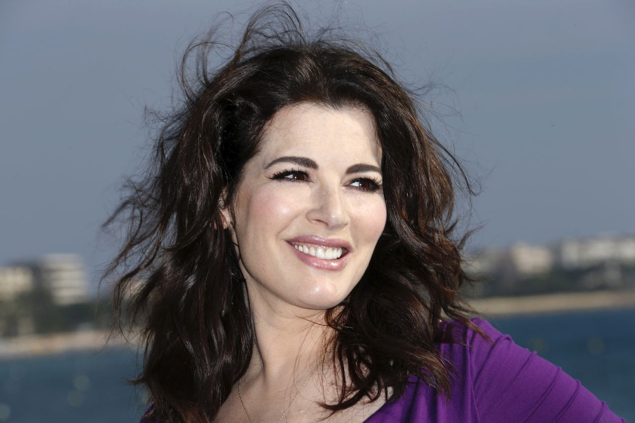 "British TV chef Nigella Lawson poses during a photocall for the television show ""Nigellissima"" as part of the Mipcom international audiovisual trade show at the Palais des Festivals, in Cannes, southeastern France, on October 9, 2012. AFP PHOTO / VALERY HACHE"