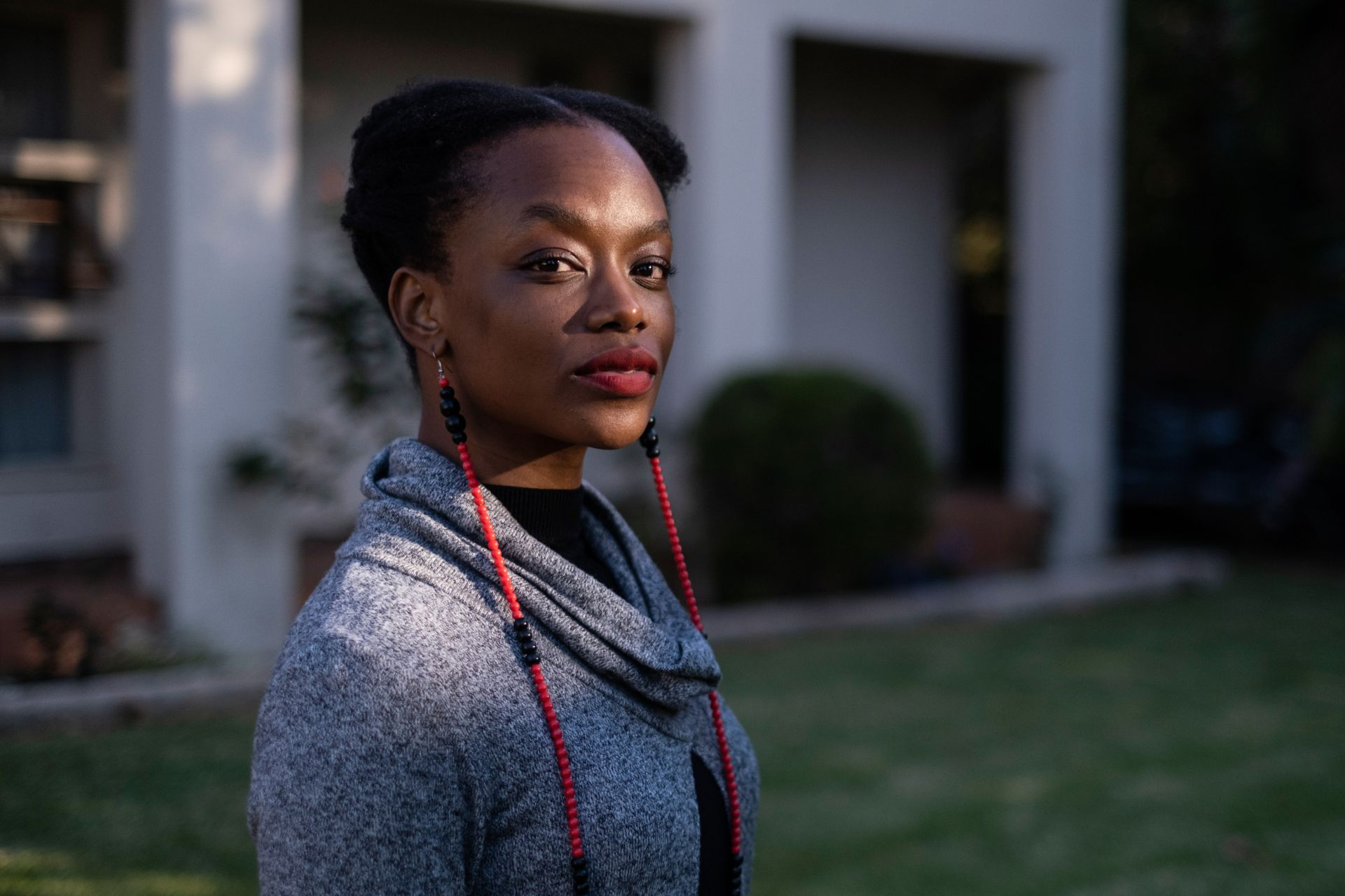Tendaiishe Chitima, the lead actress in the Zimbabwean film Cook Off, poses for a portrait at her home in Sandton on May 28, 2020. - Cook Off will be available to stream on Netflix on June 1, 2020. (Photo by WIKUS DE WET / AFP)