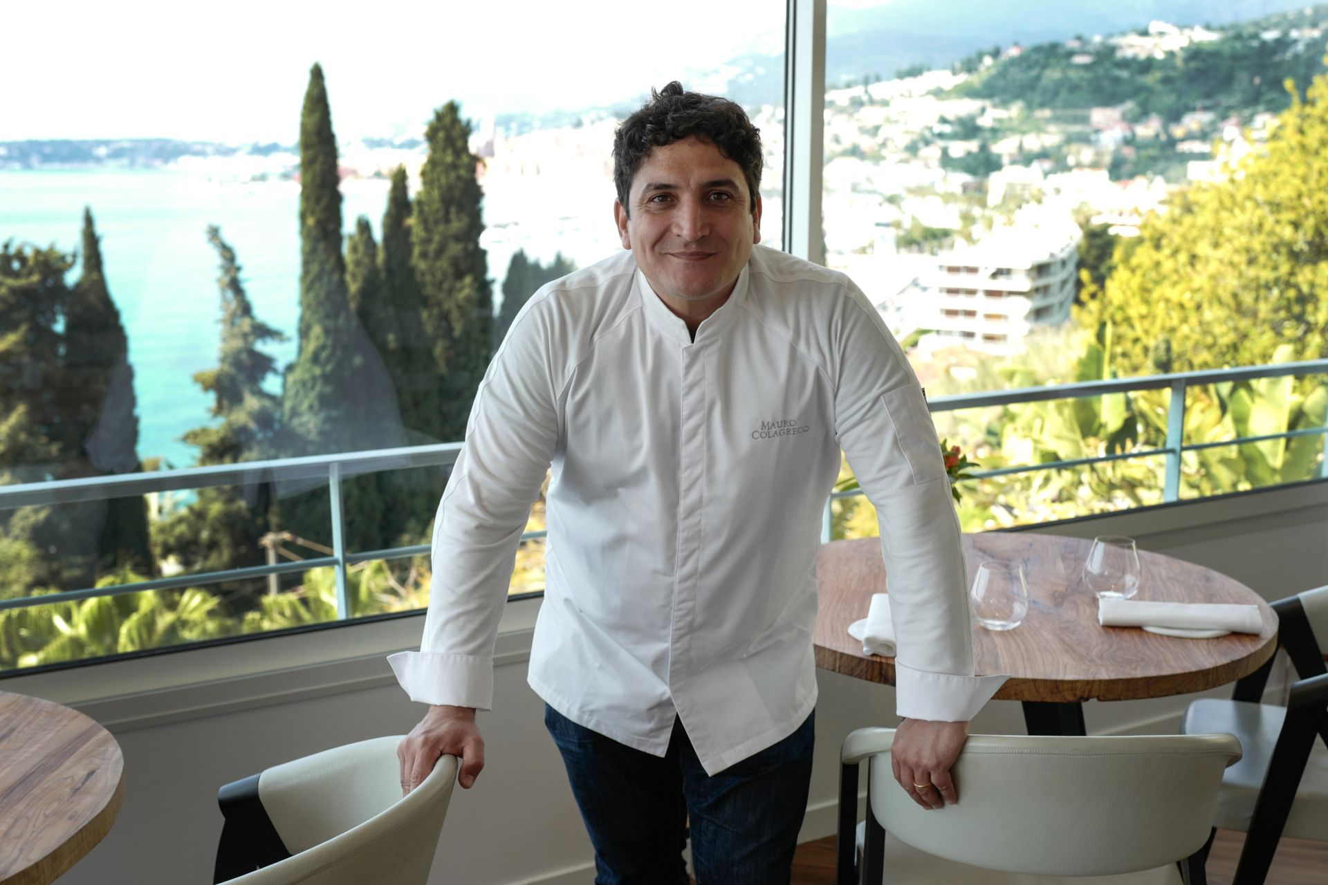 """Italian-Argentinian chef Mauro Colagreco poses for a photo session in the """"Mirazur"""" restaurant on the French riviera city of Menton on April 13, 2019. - Mauro Colagreco was awarded three Michelin stars on January 21, 2019. (Photo by VALERY HACHE / AFP)"""