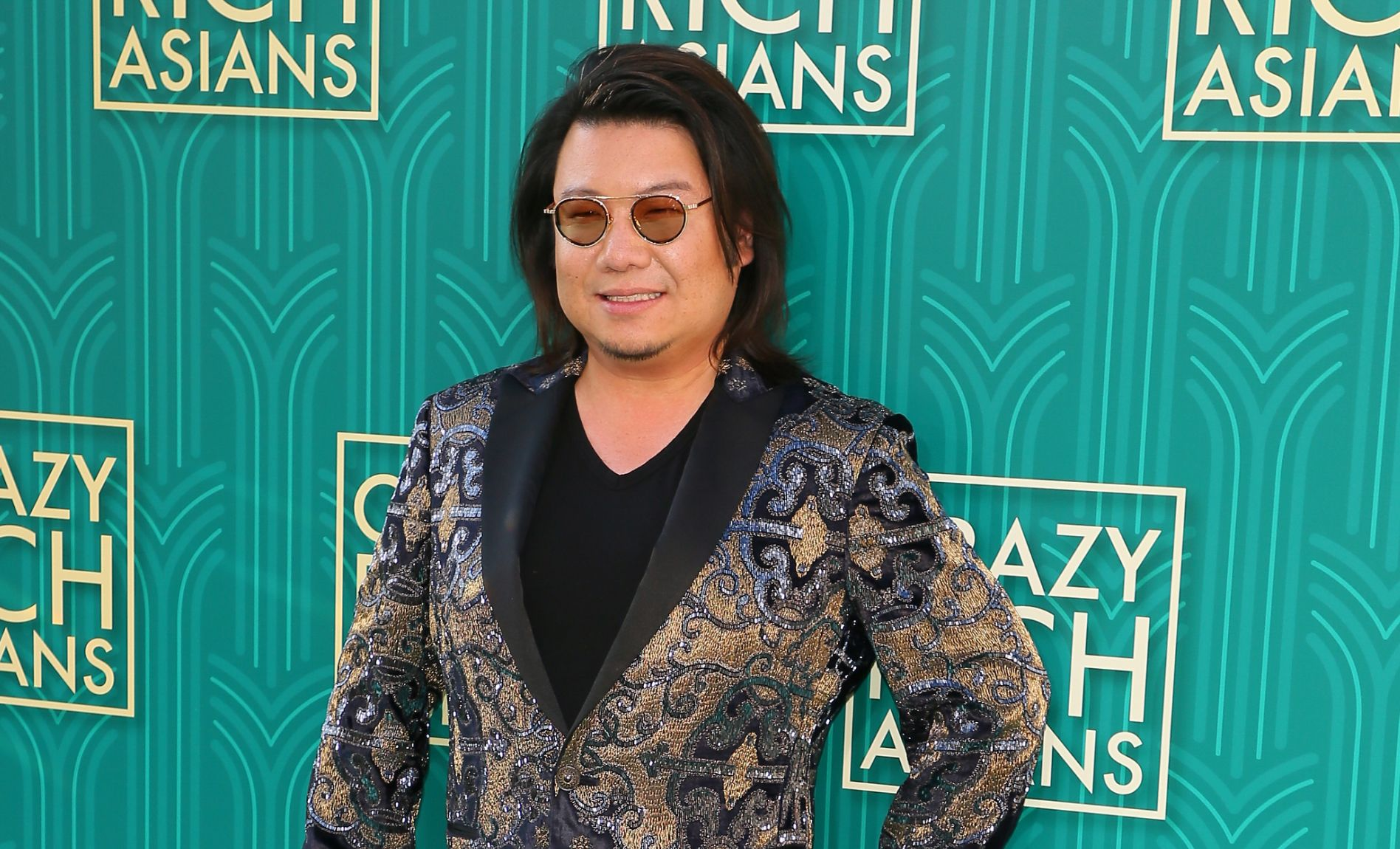 """Novelist Kevin Kwan, author of """"Crazy Rich Asians"""", attends the premiere of Warner Bros Pictures' """"Crazy Rich Asians"""" in Hollywood, California, on August 7, 2018. (Photo by JEAN-BAPTISTE LACROIX / AFP)"""