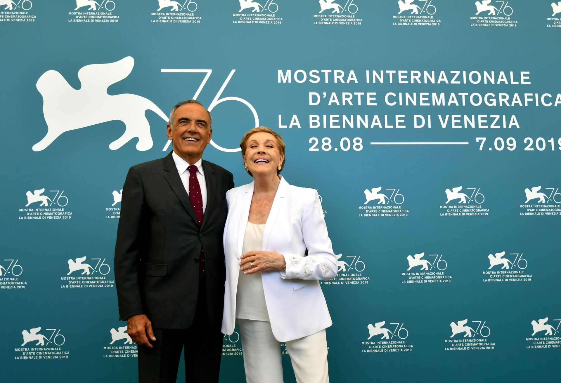 British actress Julie Andrews (R) and Director of the Venice International Film Festival Alberto Barbera pose during a photocall on September 3, 2019 during the 76th Venice Film Festival at Venice Lido. (Photo by Alberto PIZZOLI / AFP)