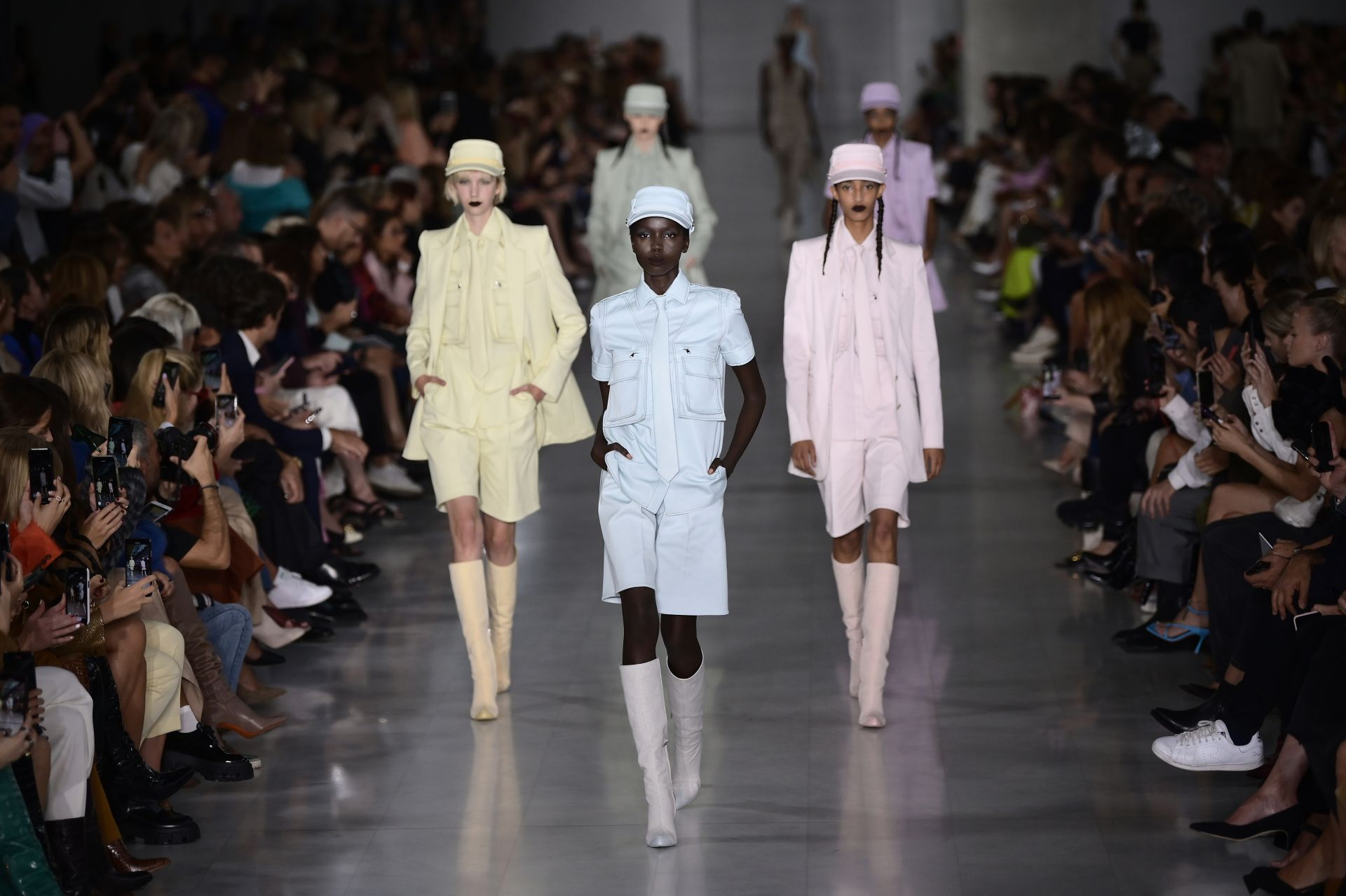 Models present creations during the Max Mara Spring/Summer 2020 fashion show on September 19, 2019 in Milan. (Photo by MARCO BERTORELLO / AFP)