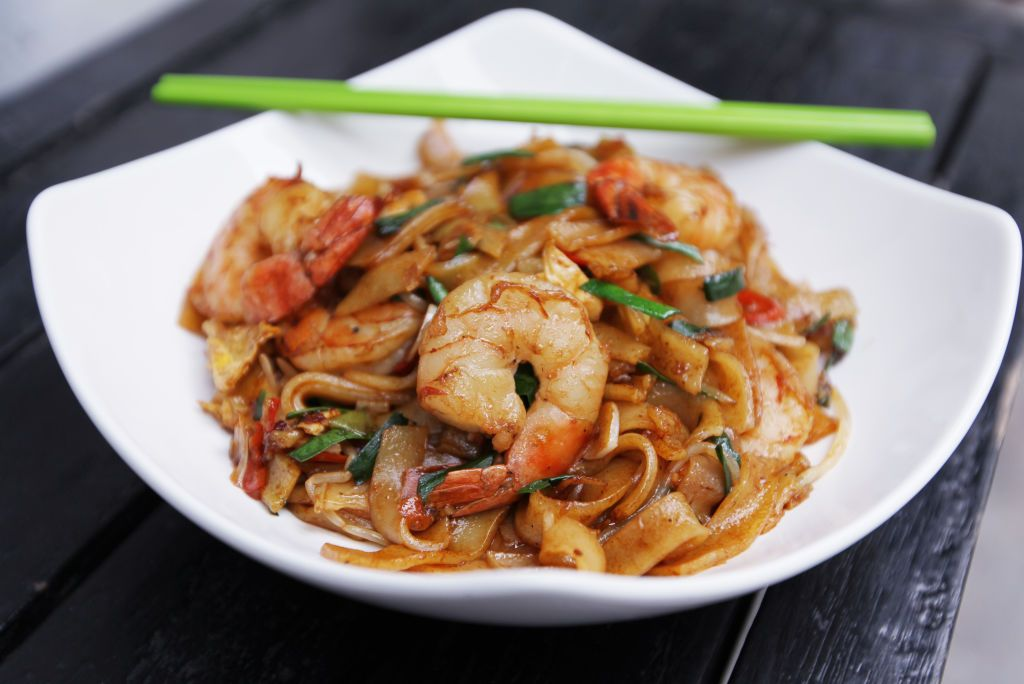 Jesse Teh, head chef of Secret Ingredients, demonstrates how to make prawn char kway teow. 19NOV13 (Photo by Nora Tam/South China Morning Post via Getty Images)