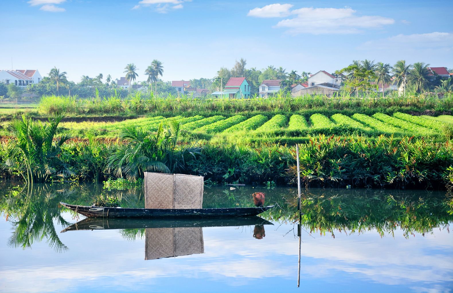 Rural landscape and small boat in Vietnam village. Composite photo