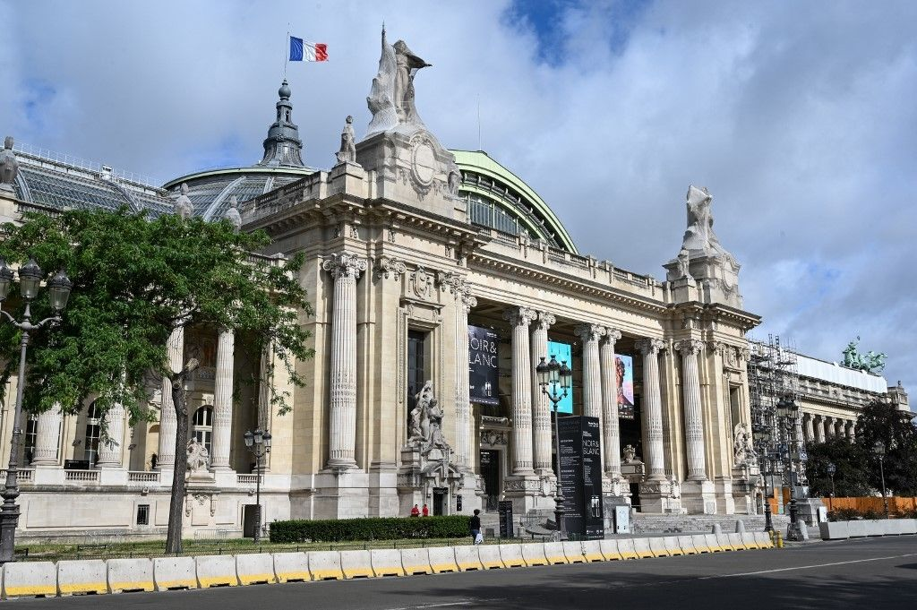 "This picture taken on July 1, 2020 shows the Grand Palais facade during the first day of the official reopening with "" Pompeii ""  new immersive 3D show in Paris. - The show was delayed by the coronavirus lockdown, meaning the treasures, rarely seen outside Italy, had to be locked away for safekeeping by French authorities. (Photo by BERTRAND GUAY / AFP)"