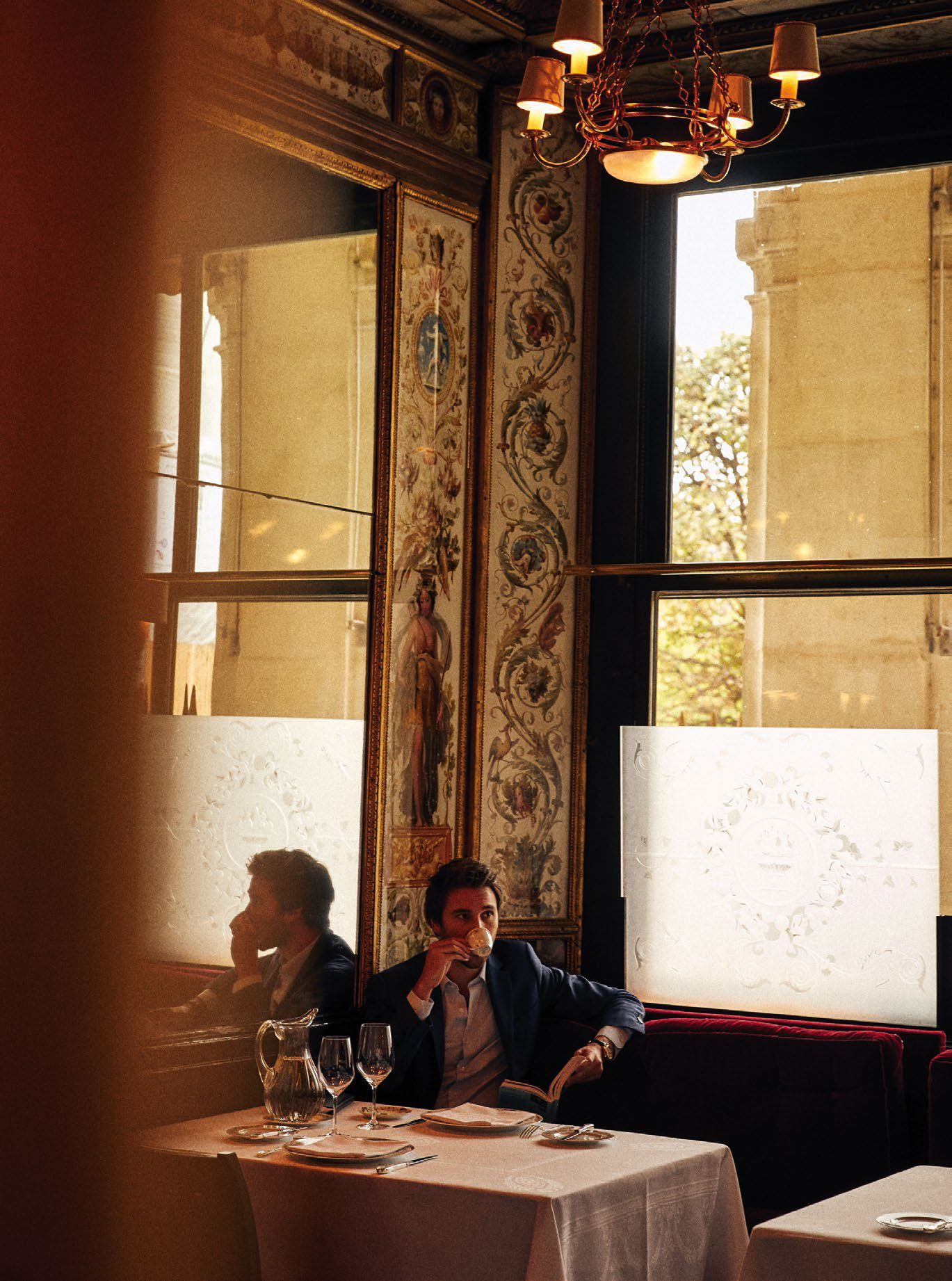 A candid photo of a man at a Parisian restaurant
