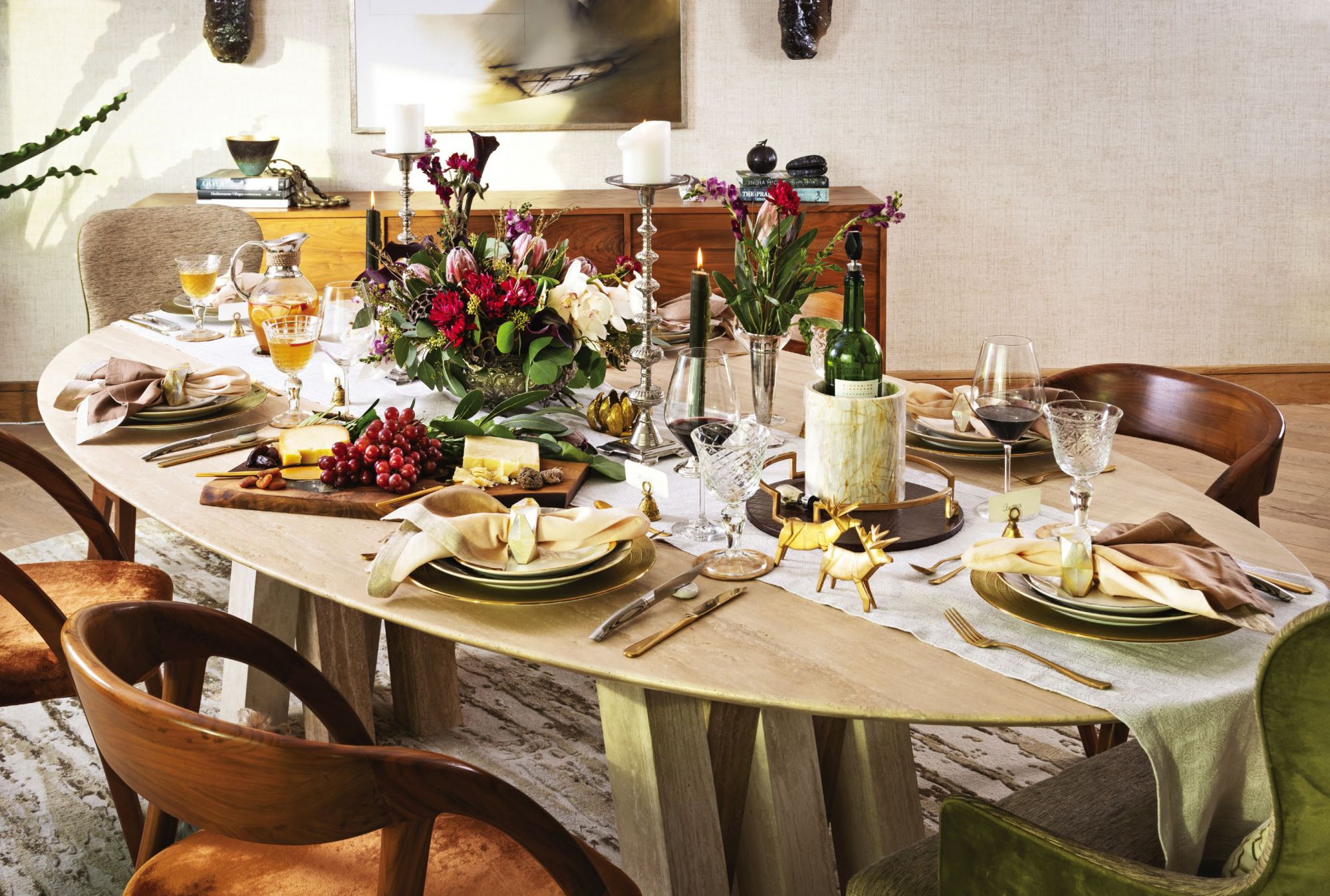 Embla dining chair and buffet table, and Polk chair at Philux; napkin ring, gold capiz coaster, solid walnut slab, silver candelabra, marble wine holder, circular decorative tray at Philux Home; flowers by Spruce Floral Designs; a delectable spread of foie gras with Asian fruit compote mesclun salad, deep sea scallop mille feuilles chive, braised lamb shank with red wine sauce, white wine risotto, chanterelles with apricot—all by L'Entrecote Manila