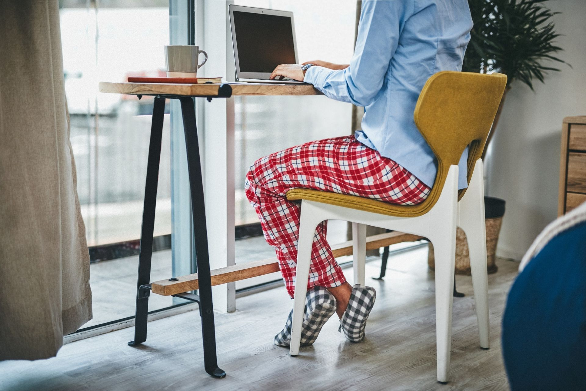 Lounge pants and slippers could become very popular this winter.  © Charday Penn / IStock.com