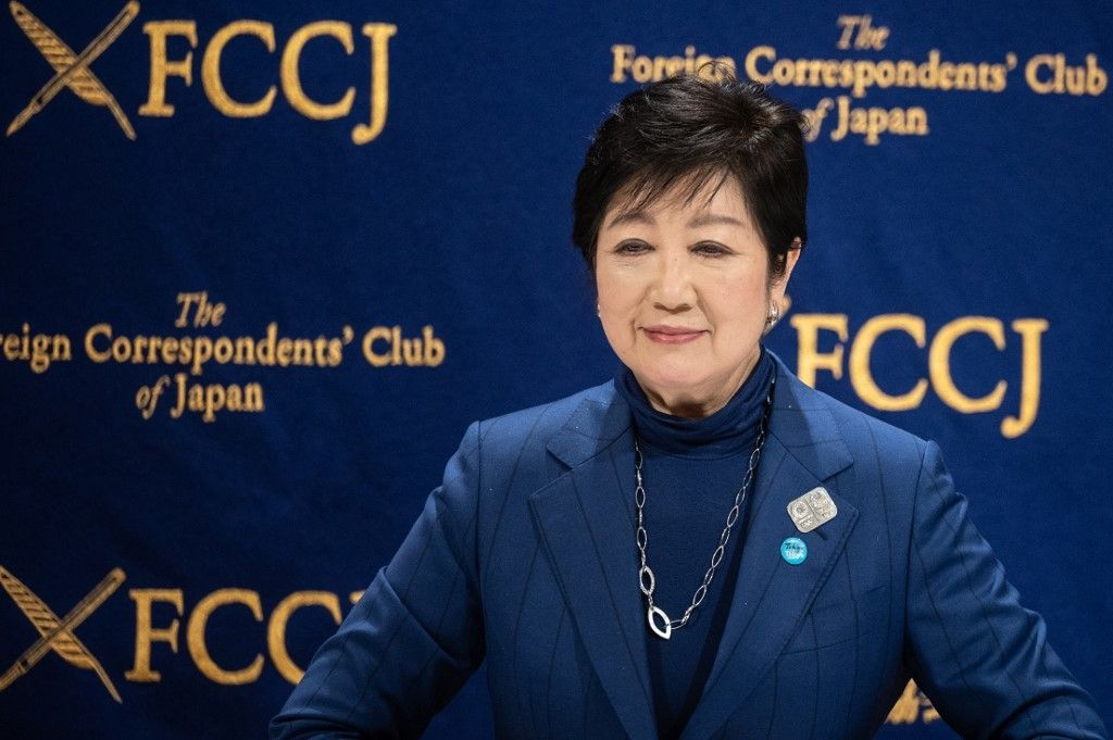 Tokyo governor Yuriko Koike poses for photos during a press conference at the Foreign Correspondents' Club of Japan in Tokyo on November 24, 2020. (Photo by Philip FONG / AFP)