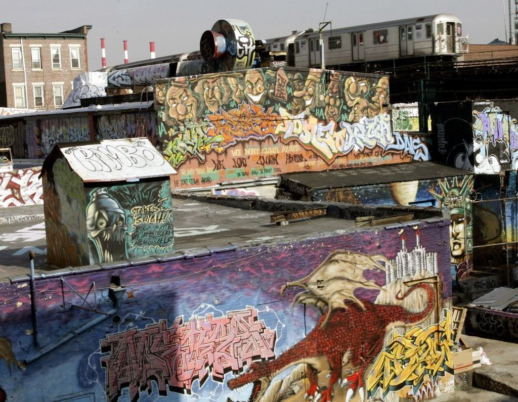(FILES) In this file photo taken on February 22, 2006, the 7 Train passes by the 5 Pointz Building in Long Island City, Queens, New York. - They have been part of the city's history for more than 50 years, but with the pandemic, graffiti is flourishing as never before in New York, a sign of decadence for some, or vitality for others. (Photo by Timothy A. CLARY / AFP)