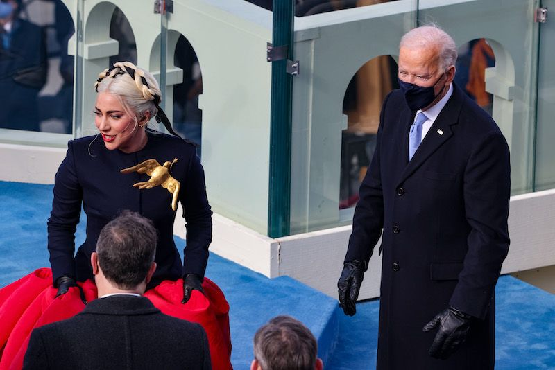 Lady Gaga reacts with President-elect Joe Biden after singing the National Anthem at Biden's inauguration on the West Front of the US Capitol on January 20, 2021 in Washington, DC. - During today's inauguration ceremony Joe Biden becomes the 46th president of the United States. (Photo by Tasos Katopodis / POOL / AFP)