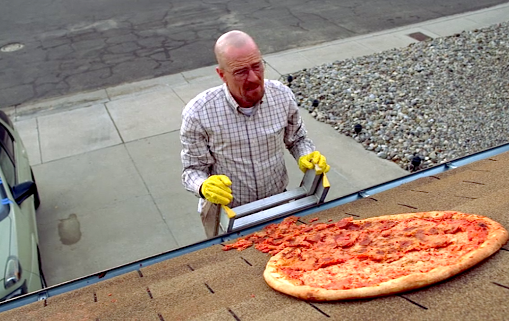 Walter White finds the pizza he accidentally threw on the roof  (Photo from Breaking Bad: Season 3, Ep. 2)